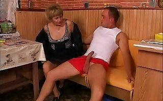 Mature woman seduces a boy with a strong erection