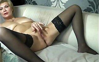 Blonde mature masturbates on webcam