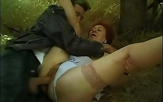 A mature woman picks up a boy forcing him to fuck her hairy pussy