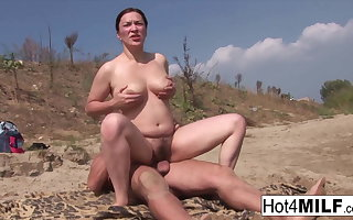 Busty MILF here natural tits fucks on the beach