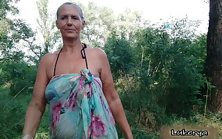Lukerya takes off her bra down the forest